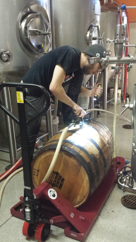 Keigan flushing and filling the barrel with water to ensure that it seals.